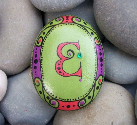 "Hand Painted Initial Rock - Letter ""E"". $12.00, via Etsy."