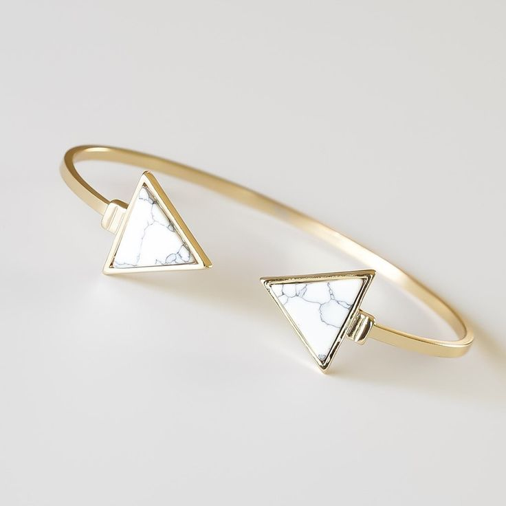 """- This chic, sophisticated open ended bracelet features two white marble triangles at the ends. - 18k gold plated - 2.32"""" diameter, adjustable"""