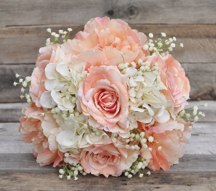 Silk wedding bouquet made with peach roses, peonies, ivory hydrangea and babies breath. Find this bouquet on Etsy at Holly's Flower Shoppe.