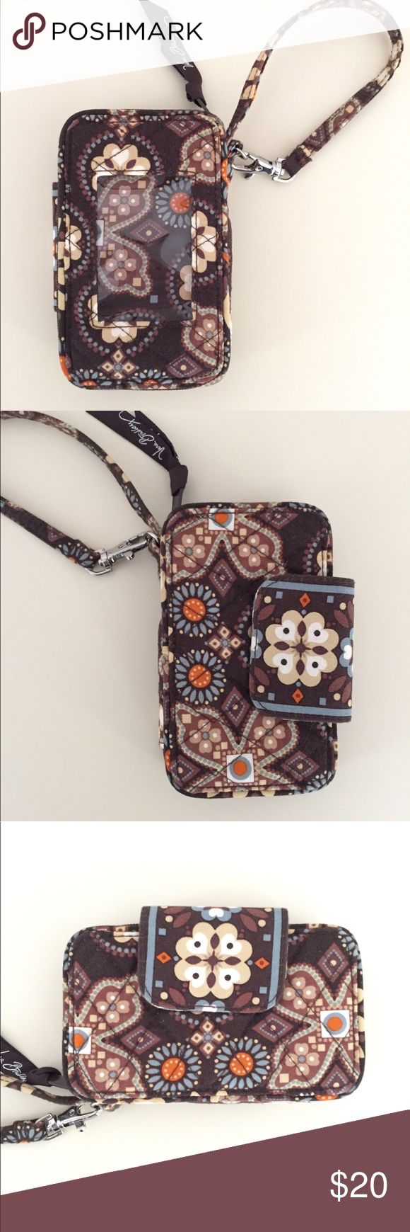 "Vera Bradley Smartphone Wristlet in Canyon Used and in great condition! There is slight wearing on zipper pull but is not very noticeable (see photo). This wristlet is perfect for use on it's own or as a wallet within your purse! Great organization and can even fit an iPhone 6!  Color: Canyon (retired pattern)  Approximate Measurements: 5.5""W x 3.5""H x 1.5""D Wristlet Strap Drop: 5""  Features: * zip around opening  * 3 card slots * ID window * interior zip compartment of change  * slip pocket for folded cash & receipts Vera Bradley Bags Clutches & Wristlets"