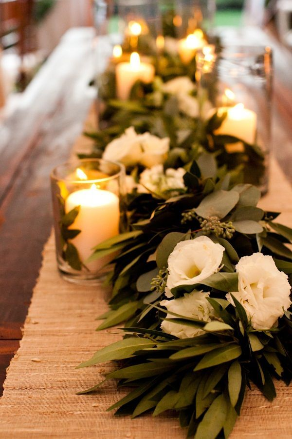 Here is a simpler garland.  You can add your wedding colors in the flowers, still do a lace topper w/grey, coral or champagne (?) linen under, tall centerpieces, white chairs, chandeliers overhead - very elegant