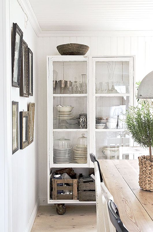 "love the juxtaposition of the pretty glassware with the rustic crates. very ""real life"" :)"