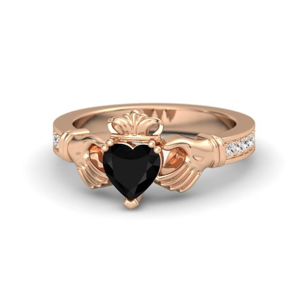 Claddagh Ring. This is beautiful, black or red. But with red it would look better with silver.