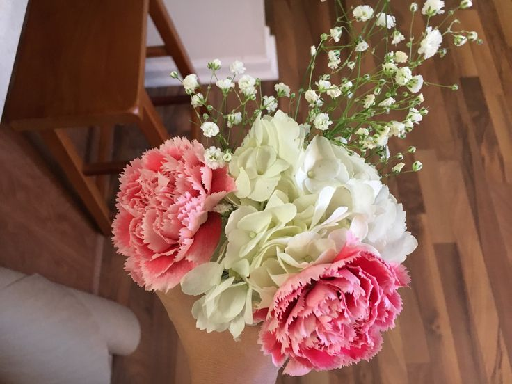 These are the colors I like for the bridesmaids bouquet (light green, light or bright pink, white). you can use roses or camellias for the pink. You can add some greeneries if you think it is pretty. The bride and bridesmaids can have same colors.   For the brides bouquet, I like the Majority of the flowers to be white and then add some greenery, and light green and Bright pink flowers.
