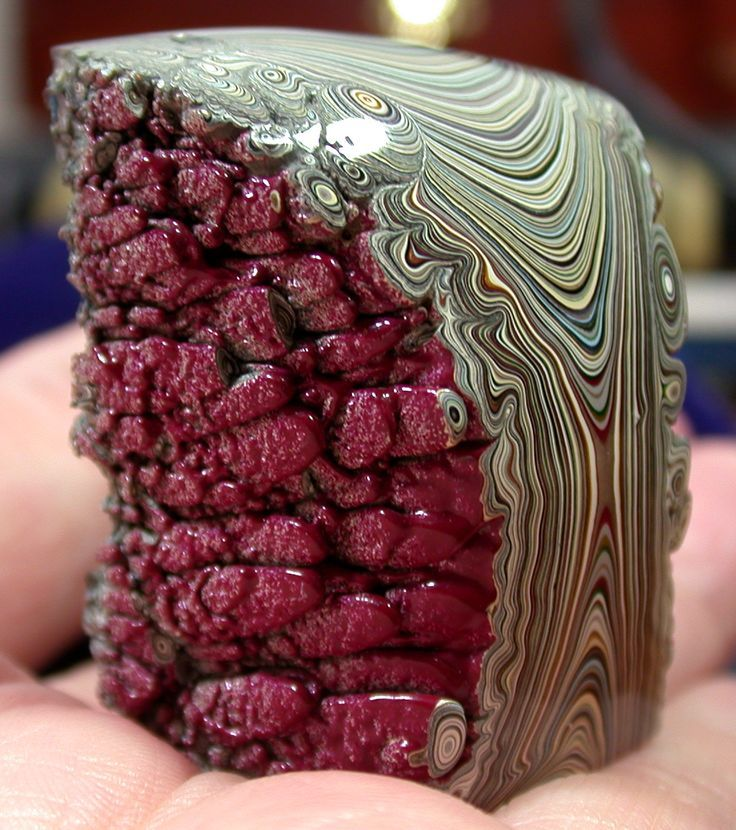 Fordite or Detroit Agate. It's layers of excess automotive paint that built up on the racks used to hang car parts from when they're being sprayed and baked.