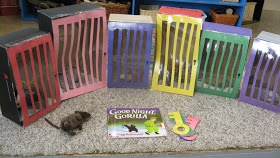 """Retell """"Goodnight Gorilla"""" with this set of shoebox cages with color-coded doors and keys."""