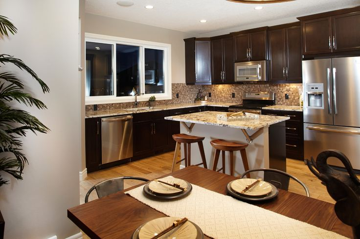 The Rowan Kitchen in Nolan Hill – Trico Homes – Check out the new homes built by www.tricohomes.com #homebuilder #tricohomes #calgary