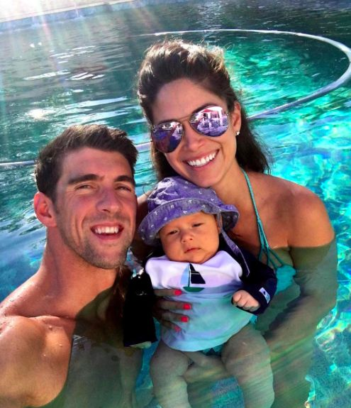 Olymic swimmer Michael Phelps and his fiance Nicole Johnson take their son Boomer for his first swim.
