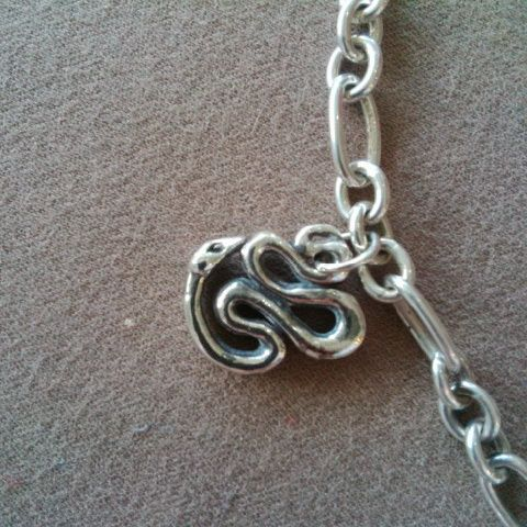 This #Snake #Chinese #Zodiac #pendant #bracelet #charm or #ring was lovingly #handcarved by #Tara Shelton and cast into #sterling silver. Price $165.00 CDN. See more of #artisan Tara Shelton's #jewelry #jewellery at #ArtisansAtWork/ #AAWGallery www.aawgallery.com and www.tarashelton.com