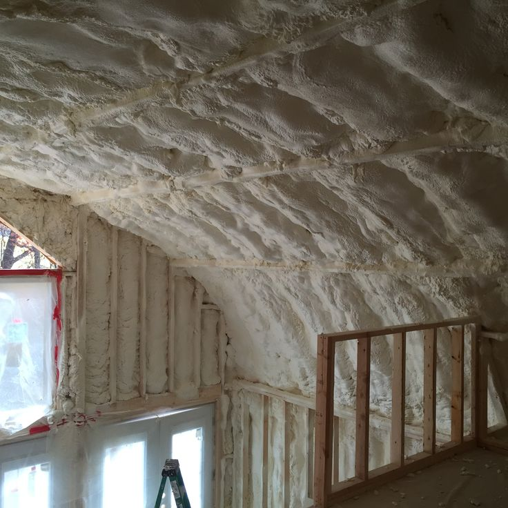 Spray foam insulation on ceiling of quonset hut.