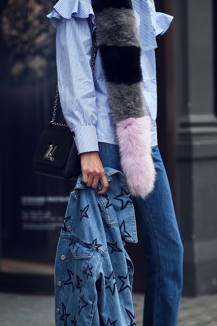 More ruffles! This time, they're dressed down with double denim (jeans and a jacket) and a furry Charlotte Simone scarf.Miu Miu top, Louis Vuitton bag, Charlotte Simone scarf. #refinery29 http://www.refinery29.com/2016/09/123831/lfw-spring-2017-best-street-style-outfits#slide-40