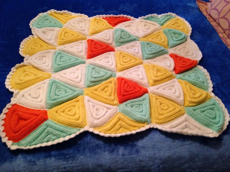 Triangles knitted on double pointed needles, 8ply baby blanket with a crochet edge