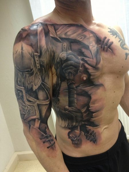 Awesome battle knight tattoo - interesting running it from the arm to the chest.