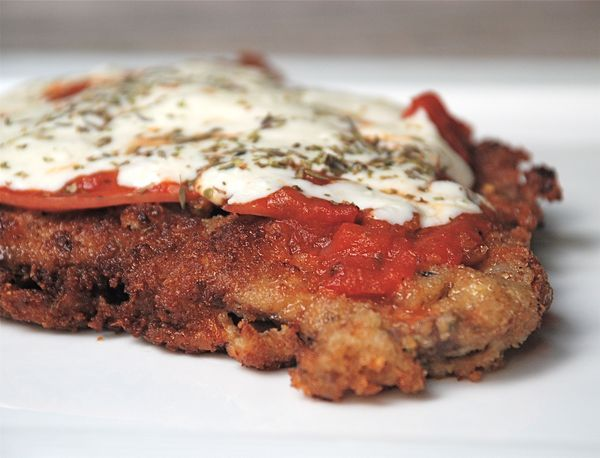 Try this Milanesa Napolitana recipe, an Argentinian favorite. Breaded fried steak is topped with ham, tomato sauce, and cheese.