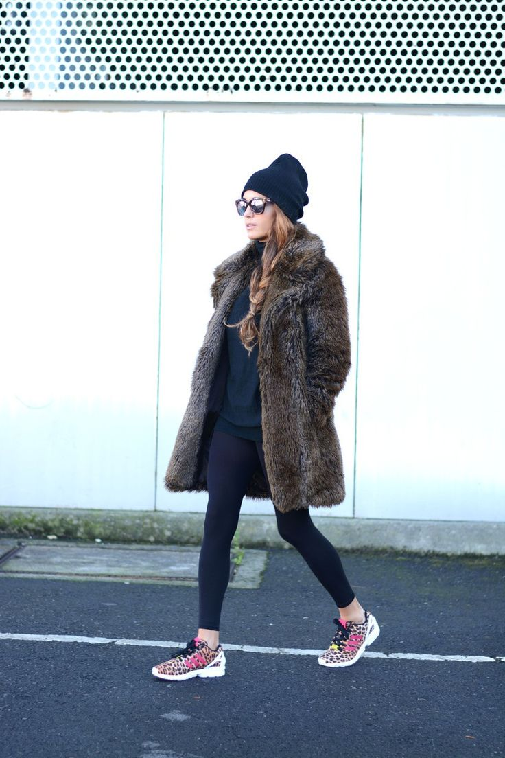 faux fur fluffy winter coat made casual with sneakers and black athletic hat
