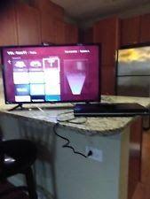 TCL 32-Inch 720p Roku Smart LED TV (2017 Model) & Toshiba DVD Player