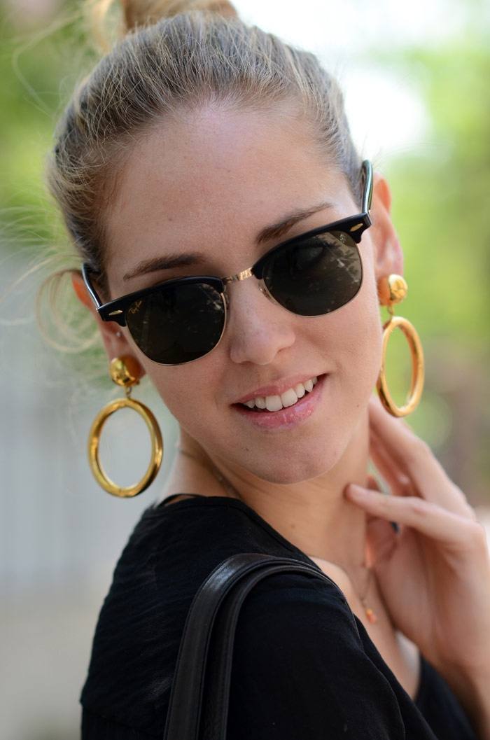 Chiara Ferragni of TBS wearing Rayban Clubmaster Sunglasses and Moschino earrings