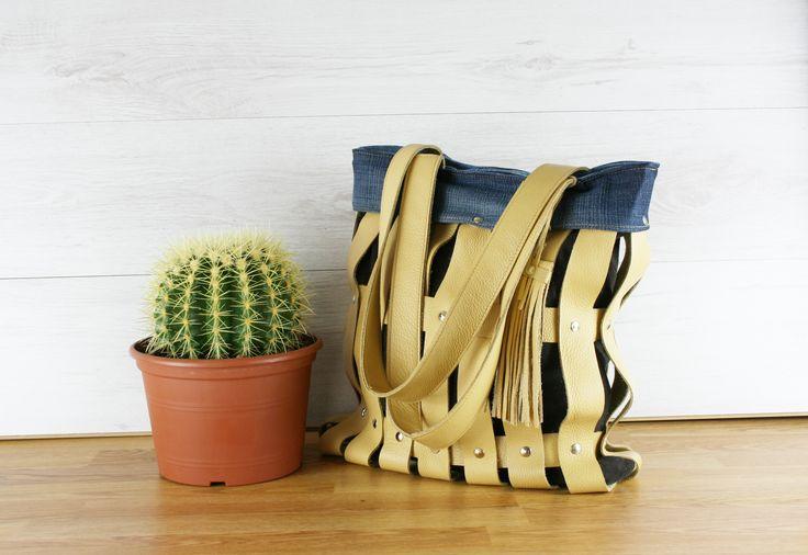 Hergebruikt leer en hergebruikte jeans voor deze nieuwe tas.