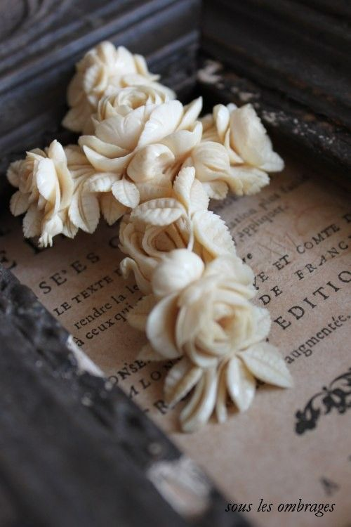 Carved Ivory floral cross.