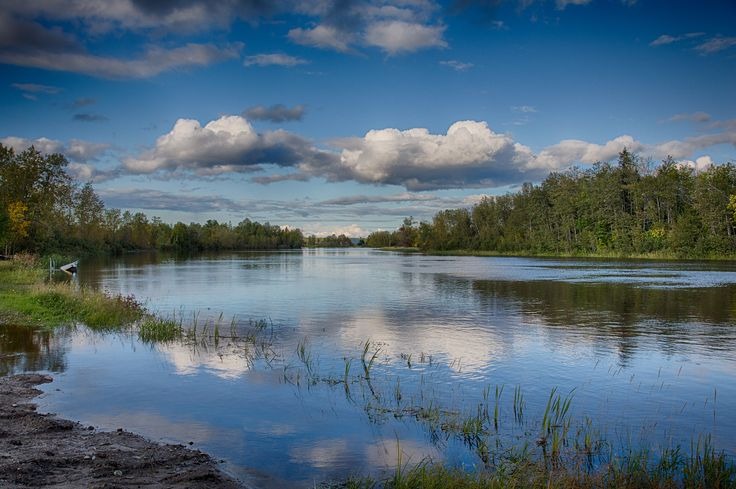 Clouds over the Mattagami River and their reflection in the water. Along Norman Street in Timmins. HDR Efex Pro 2 Outdoor 2 from 3 exposures.
