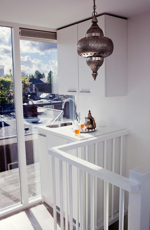 Een dakhuis kan je heel leuk inrichten, bijvoorbeeld met een keukenblokje
