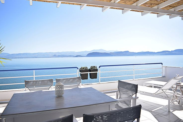 A sunny day on the seaside balcony. Meli Waterfront  Holiday Loft Apartment just on the beach.  Visit our website http://melimare.com/holiday-loft-apartment-kiveri-nafplio/ or Follow us in facebook: https://m.facebook.com/meliapartments/ , in twitter: @apartmentsmeli #holiday, #vacation, #summer, #Nafplion, #kiveri, #meliapartments
