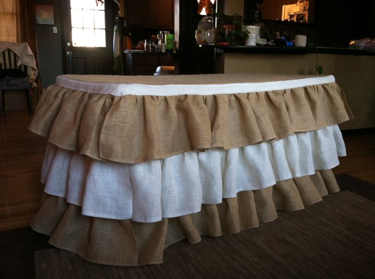 Burlap ruffle table cloth, with white. For a neutral themed baby shower. Made from scratch.