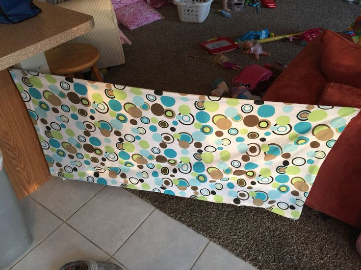 Home made baby gate. Old shower curtain, twine and some command hooks!