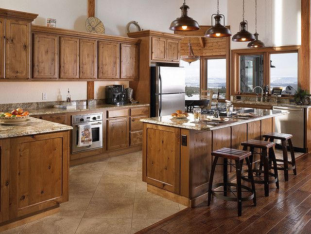 more natural-looking wood cabinets with light granite countertops... maybe?