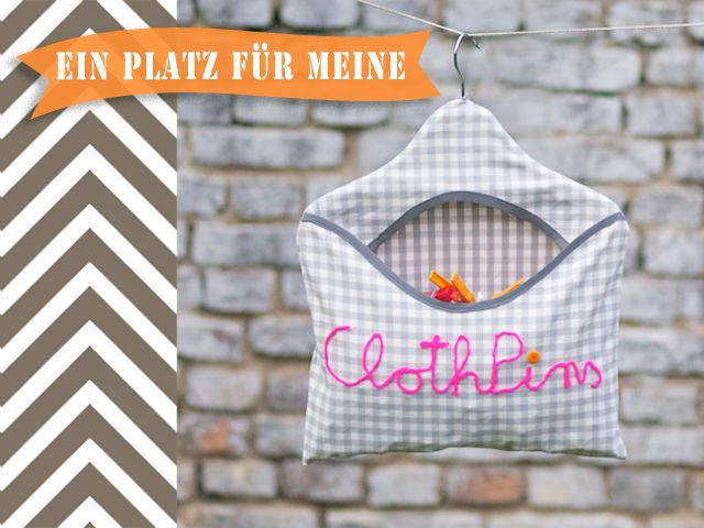 clothespin bag - covered hanger, bias tape, and couching yarn to form letters - tutorial in German, but translate page