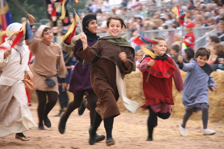 Children race into the arena before the donkey palio in Alba. #Italy #Piedmont