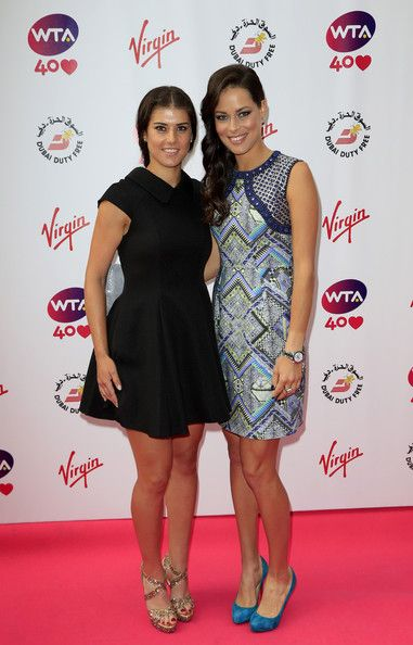 Sorana Cirstea and Ana Ivanovic attend the annual WTA pre-Wimbledon party at Kensington Roof Gardens on June 20, 2013 in London, England.