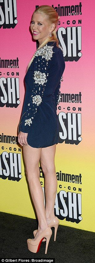 In the navy: The American Pie star rocked a heavily embellished mini-dress that skimmed her thighs at the exclusive party