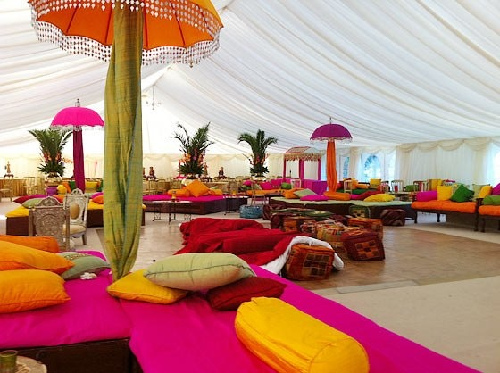 Giant umbrellas & seating arrangement? Colourful marquee. Apt for a summer wedding