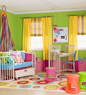 A rainbow of bright hues shines through this room and touches everything from pillows to walls. When using a strong palette of colors, repeat a particular element to create a sharp look. In this room, circles take the leading role, appearing on bedding, walls, the rug, and artwork. Also use a neutral color, such as white, for furniture, to soften bold colors.