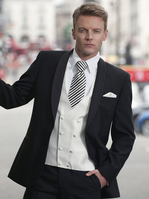 Peppers Suit Hire - Semi Formal Evening:       BERLIN     black dinner suit with satin shawl lapel. Worn with an ivory waistcoat and an ivory and black striped tie.