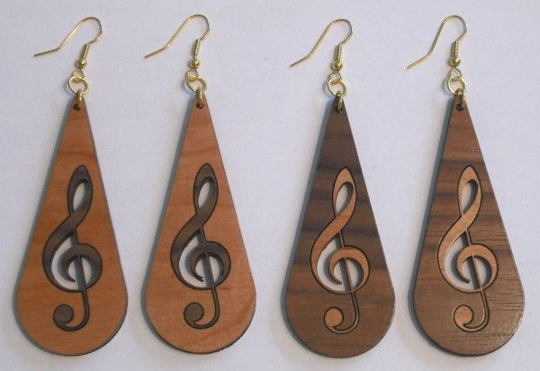 """Triangle Custom Creations - Music Treble Clef Inlay Wood Dangle Earrings, $18.00. Available in: Cherry Wood with Walnut Inlay, or Walnut Wood with Cherry Inlay. Size:  3 1/4"""" Long, 1 1/2"""" Wide. Very Lightweight. We do custom laser engraving and laser cutting for jewelry designers. Email us for a quote. (http://www.trianglecustomcreations.com/treble-clef-inlay-wood-earrings/?page_context=category #trebleclefearrings #musicearrings #woodearrings #lasercut"""