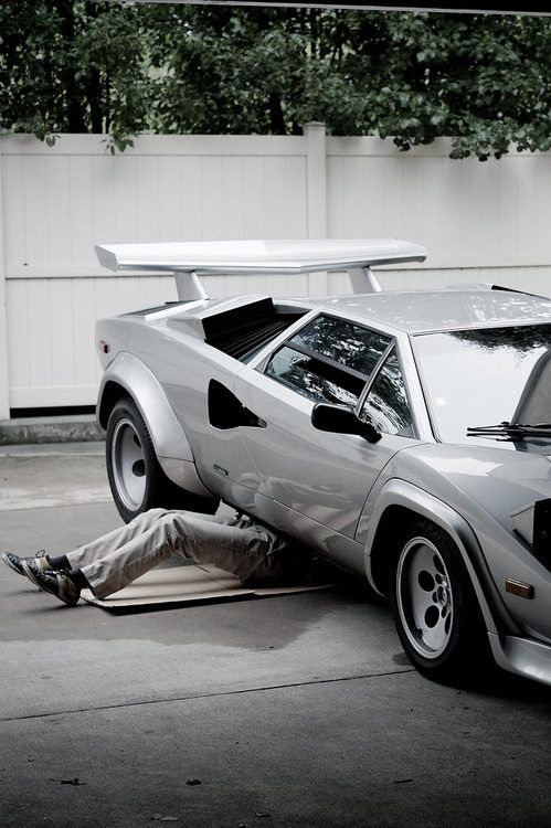 Maintenance on a Lamborghini Countach.