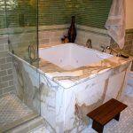Dazzling-Soaking-Tub-method-San-Francisco-Asian-Bathroom-Inspiration-with-Asian-bidet-body-sprays-calcutta-gold-Glass-Tile-jacuzzi-tub-Japan...