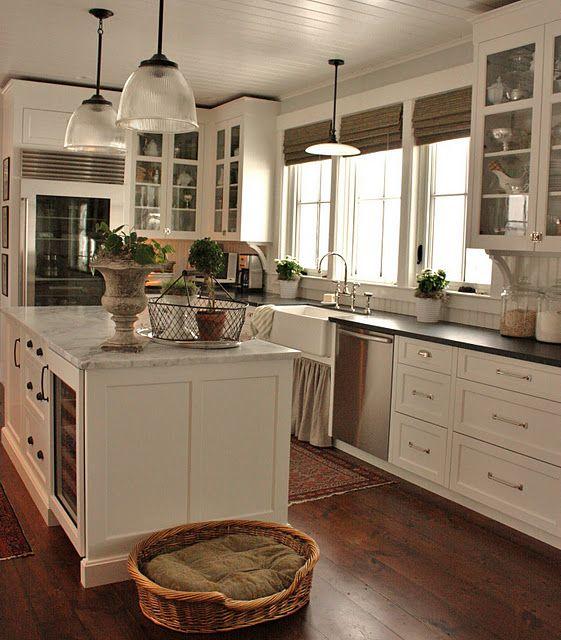 white cabinets, wood floors