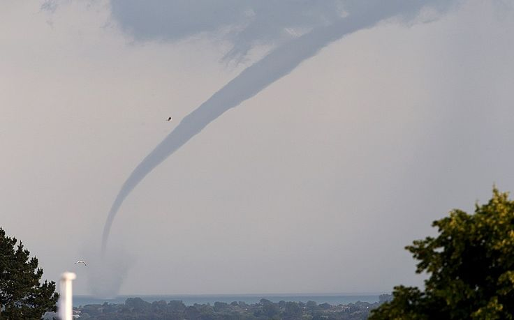A waterspout touches down in the English channel near Selsey Bill, West Sussex