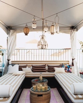 Hanging lanterns! What a relaxing outdoor patio/lounge space.