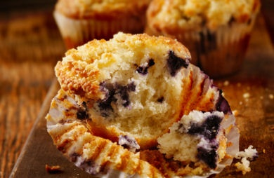"Blueberry Power Muffins with Almond Streusel:  We call these ""power"" muffins because they're loaded with B vitamins from whole wheat flour, calcium from milk and yogurt, antioxidants from blueberries, and heart-friendly monounsaturated fat from almonds and canola oil."