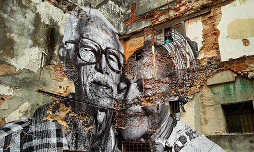 French street artist JR turns the faces and bodies of ordinary people into giant artworks on the walls of their cities