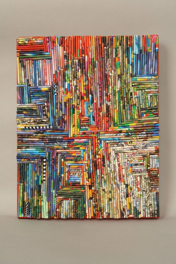 tightly rolled-up magazine pages glued onto canvas = very cool image pattern making