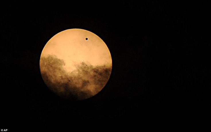 Special: The small black dot seen at the top right of the sun is the planet Venus, as it transits across the face of the sun Tuesday, June 5, 2012, as seen from Mt. Trashmore in Virginia Beach, VaThe Face, Small Black, June 2012, Planets Venus, Black Dots, Virginia Beach, Transitional June, Sun Tuesday