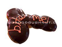 Cock-N-Balls doughnut  Cock-n-balls shaped raised yeast doughnut triple filled with Bavarian cream and topped with chocolate frosting!