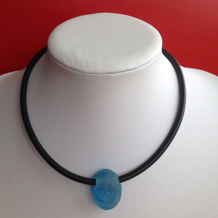 Sea glass & rubber, by Fossik.