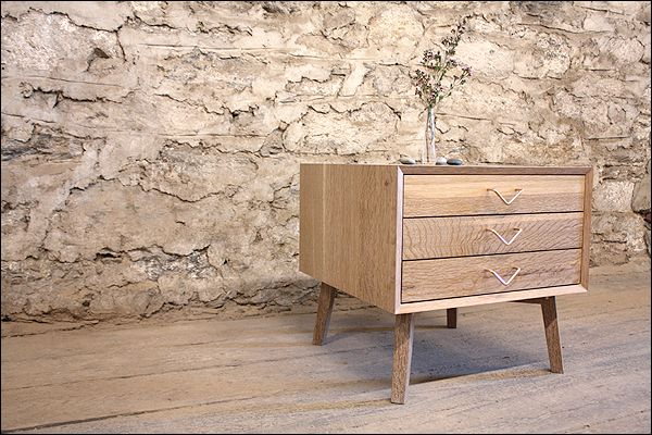 """Beautiful white oak with cerused finish is on trend with lighter wood color, unique """"v"""" shape hardware  
