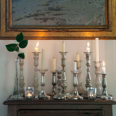 Silver candlestick holders on table: Displaying Candles Ideas